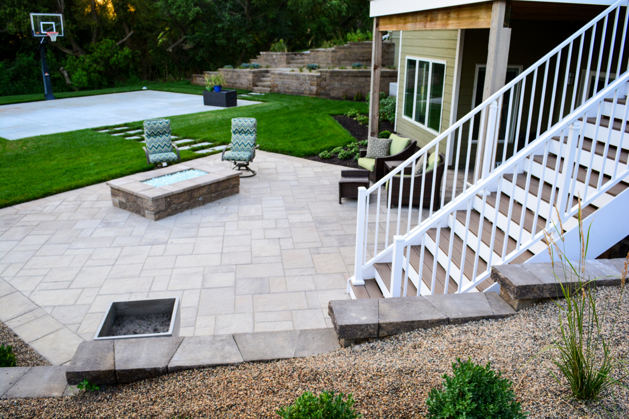 Modern Paver Patio With Custom Fire Feature By Breaking Ground Landscaping.