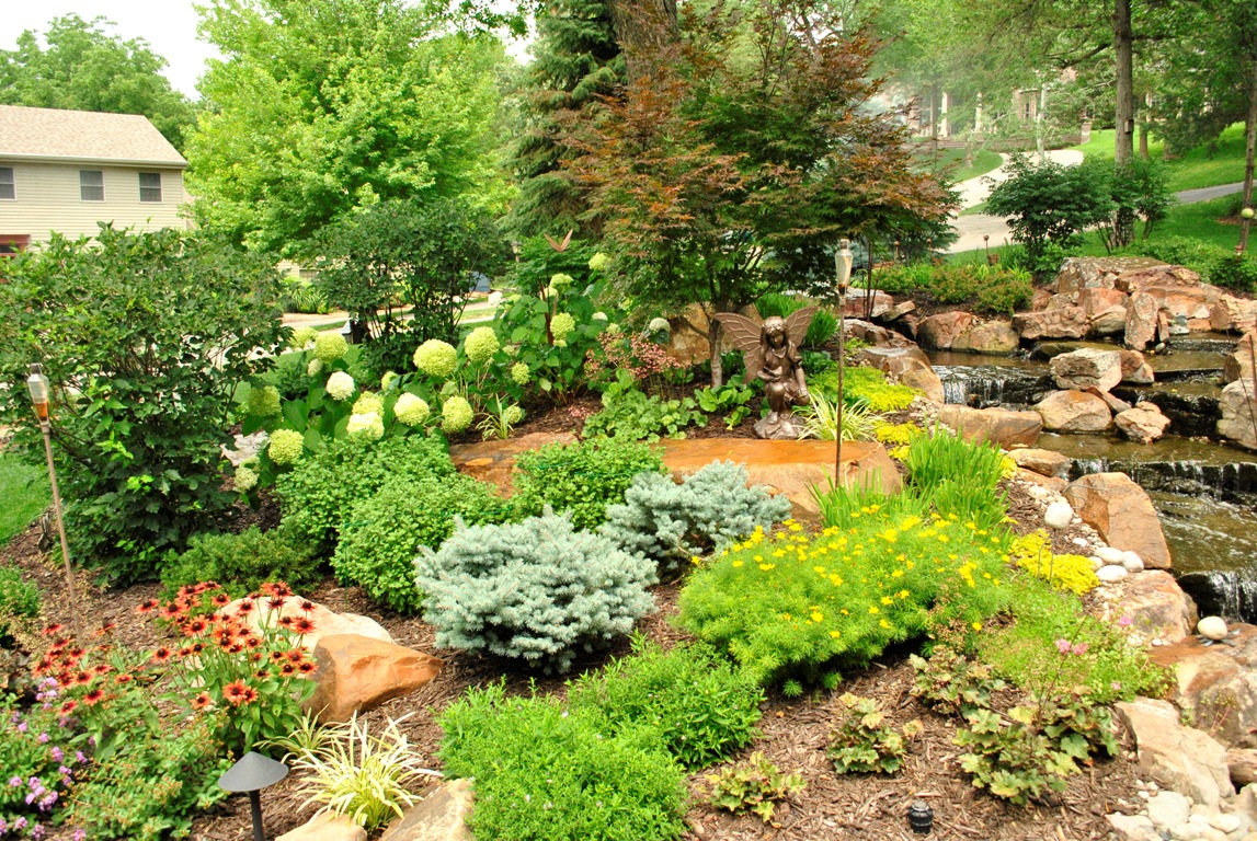 Plantings and water feature by Breaking Ground.