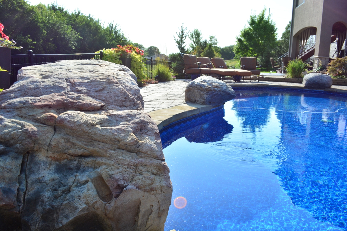 Paver and stone pool decking