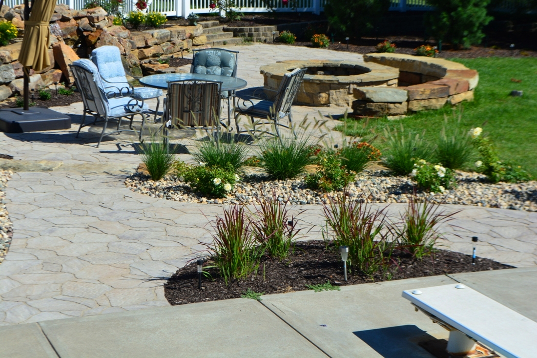 Path connects outdoor spaces by Breaking Ground