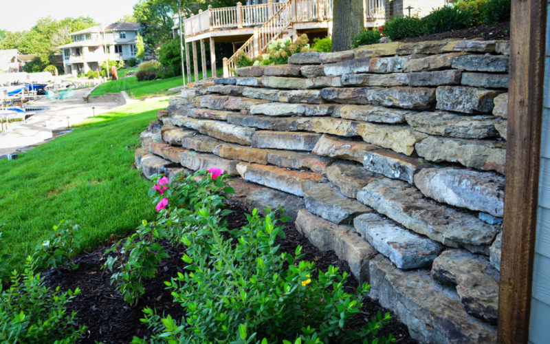 Moss rock retaining wall scott