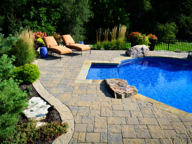 Patio and pool with rock